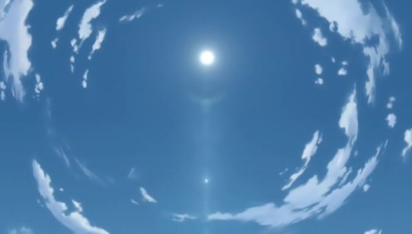 White sun in blue sky